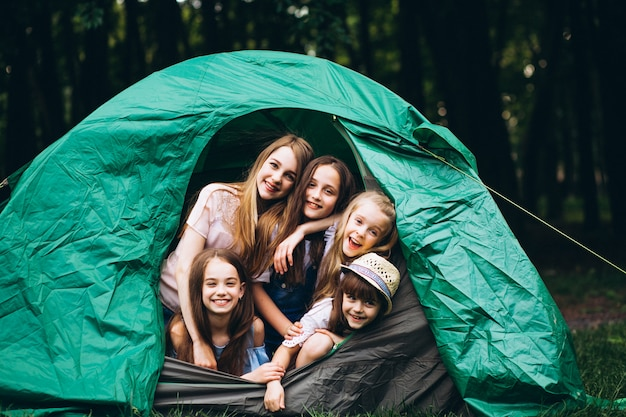 Girls in tent in forest