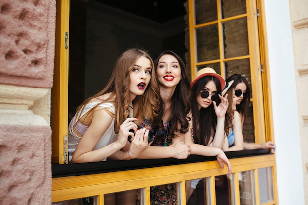 Girls on a terrace with surprised face