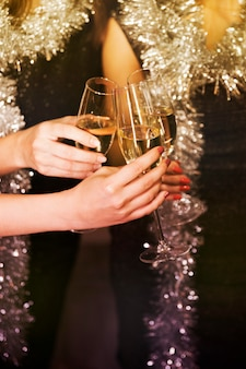 Girls toasting with champagne at new year party