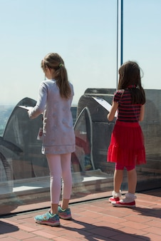 Girls at top of the rock observation deck, midtown manhattan, new york city, new york state, usa