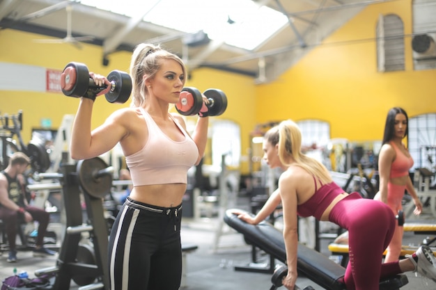 Girls training with weights at the gym