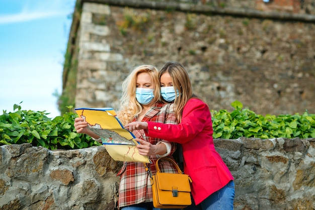 Girls using map at travelling.