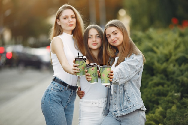 Girls walking in a spring city and taking coffee