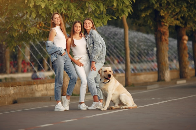 Girls walking in a spring city with cute dog