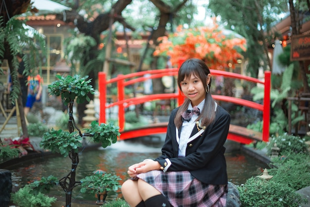 Girls wearing japanese school uniform.