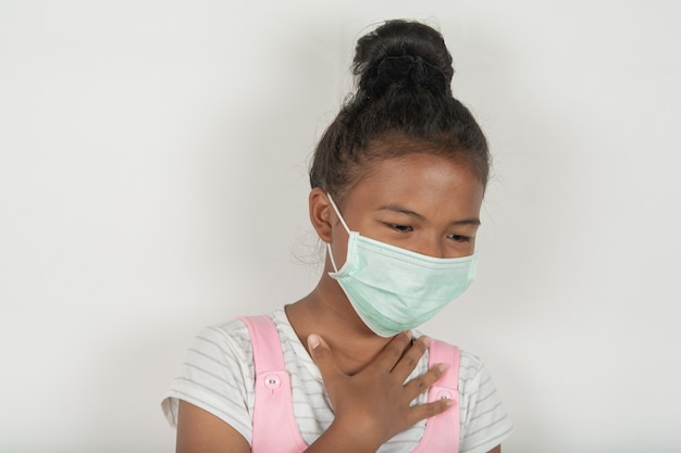 Girls wearing masks to prevent coughing and sore throat. fever and phlegm in the throat and lung infection and inflammation in the throat