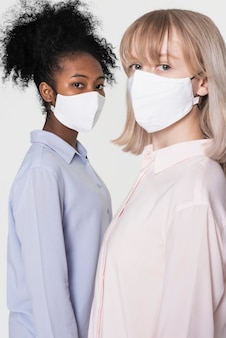 Girls wearing white face mask the new normal fashion shoot with design space