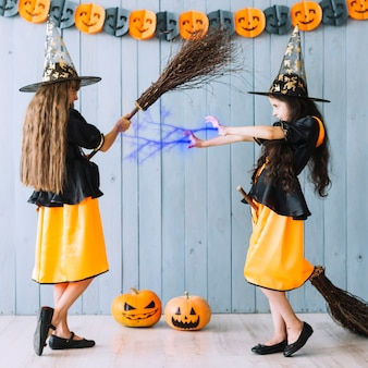 Girls in witch costumes casting spells