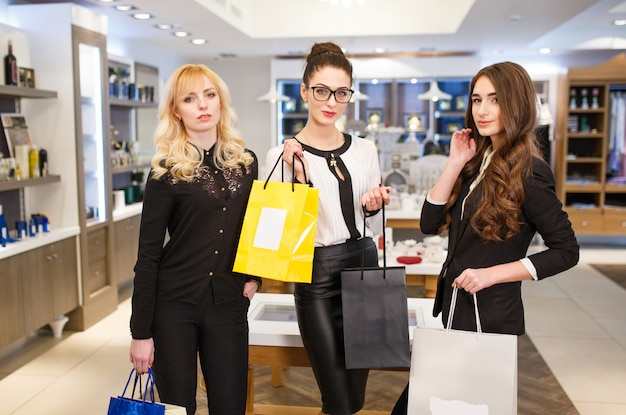 Girls with bags in a boutique.