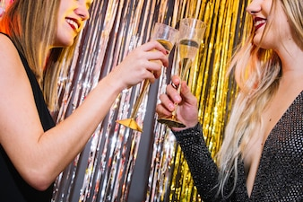 Girls with champagne at new year celebration