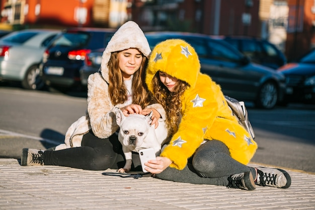 Girls with dog on street