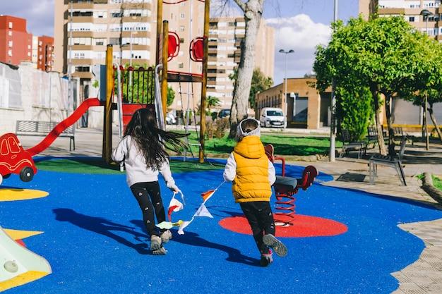 Girls with garland running through playground