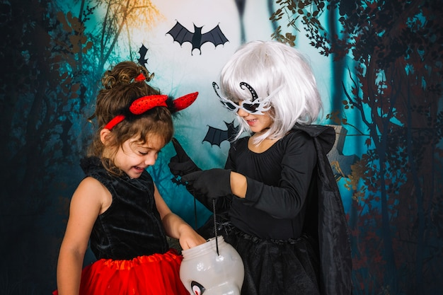 Girls with trick or treat basket