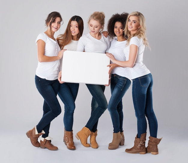 Girls with white empty poster