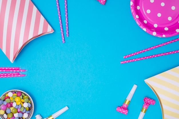 Girly birthday supplies with copy space on blue background