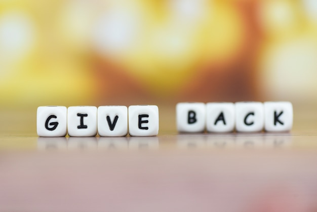 Of give back word health care, love, organ donation, family insurance and csr concept, give back text on table