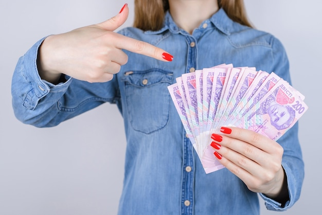 Give bill tax credit interest pawnshop earn atm investor investment people person debt economy concept. cropped close up photo of lady's hands with red manicure nail holding money isolated  background