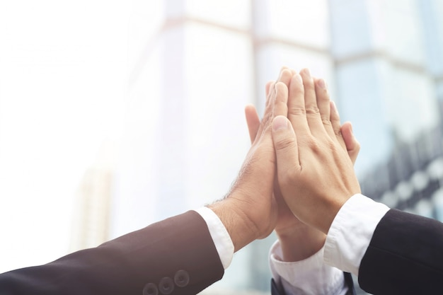 Give me five your clap hands articulate group businessman for good business team.