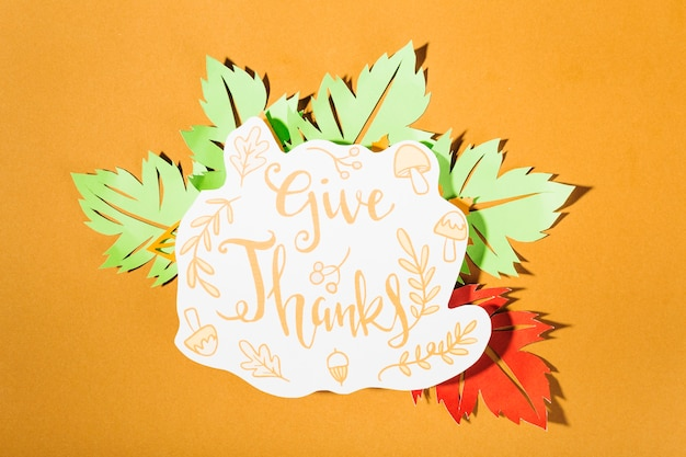 Give thanks lettering on orange background