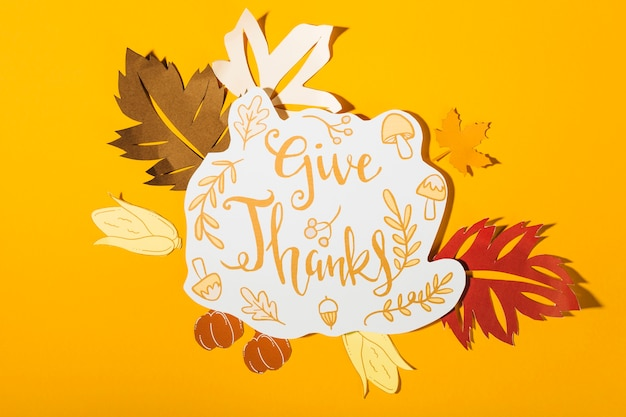 Give thanks lettering on yellow background