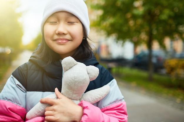 Giving hug to teddy