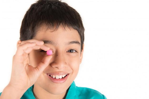 Giving kids medicine, boy try to swallow pills medicine