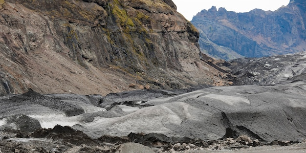 Glacier moraine and debris, rocks ground into glacial flour, in craggy mountains