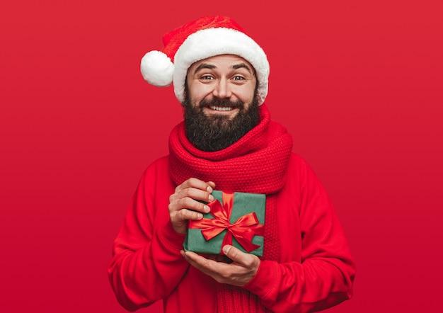 Glad bearded guy in santa hat