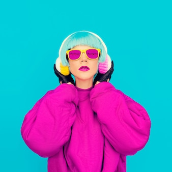Glamorous fashion lady in bright clothes listening to music. all shades of music