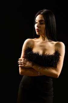 Glamorous style. fancy clothes. fashion shop. feather decorations. elegant woman fashion model. fashionable girl wearing dress with feathers. fashion concept. elegance in simplicity. black is perfect.