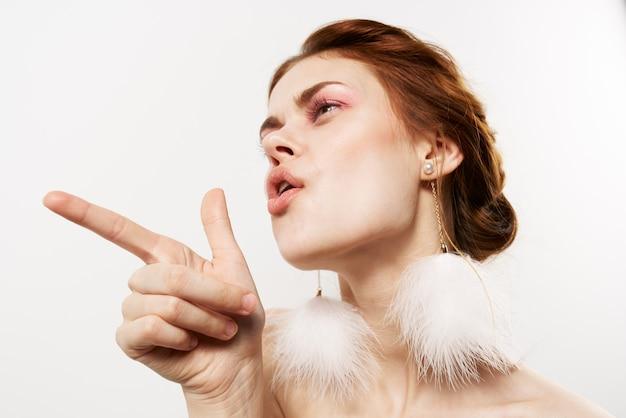 Glamorous woman bright makeup decoration naked shoulders closeup