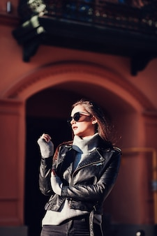 Glamorous woman in leather jacket