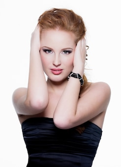 Glamour ans sensual red-haired woman with beauty make-up isolated on white wall