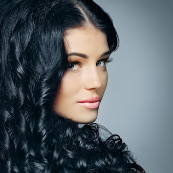 Glamour beauty woman brunette with beautiful shiny hair and makeup