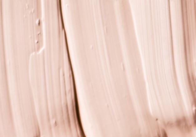 Гламурный брендинг и концепция искусства макияжа бежевая косметическая текстура фон макияж и уход за кожей косметический продукт крем губная помада увлажняющий крем макрос как роскошный косметический бренд праздничный плоский дизайн