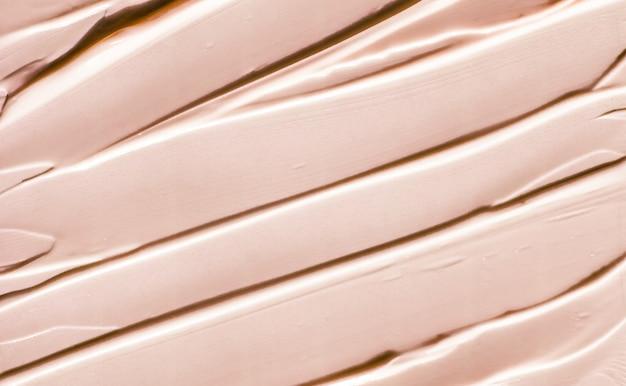 グラマーブランディングとメイクアップアートコンセプトベージュ化粧品テクスチャ背景メイクアップとスキンケア化粧品製品クリーム口紅保湿剤マクロとして高級美容ブランドホリデーフラットレイデザイン