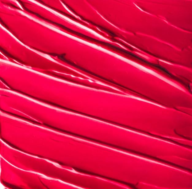 Гламурный брендинг и концепция искусства макияжа красная косметическая текстура фон макияж и уход за кожей косметический продукт крем губная помада увлажняющий крем макрос как роскошный косметический бренд праздничный плоский дизайн