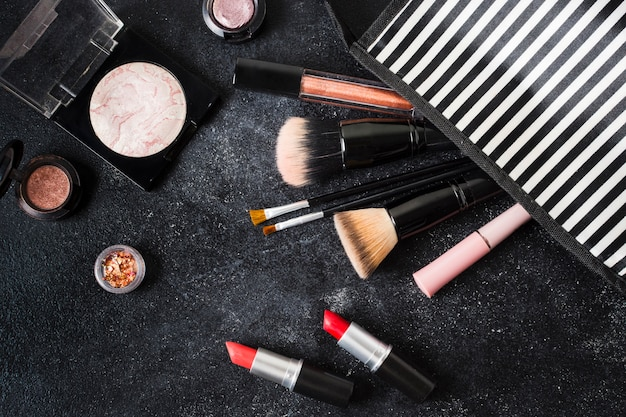 Glamour cosmetics dropped out of striped pouch
