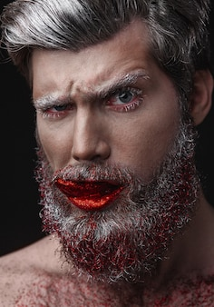 Glamour man with red lips and tongue