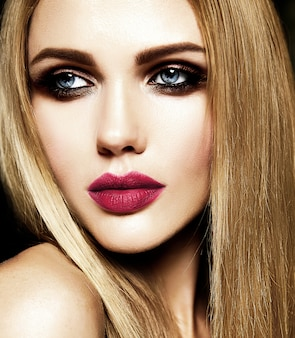 Glamour portrait of beautiful blond woman model lady with fresh daily makeup with red lips color and clean healthy skin