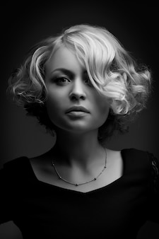 Glamour portrait of beautiful curly blonde girl