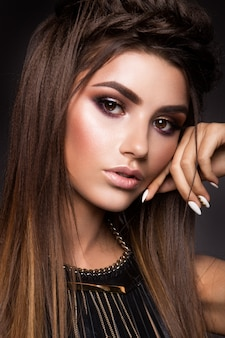 Glamour portrait of beautiful woman model with fresh makeup and romantic hairstyle.