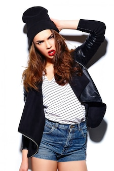 Glamour stylish beautiful  young happy smiling woman model with red lips  in casual cloth in black beanie