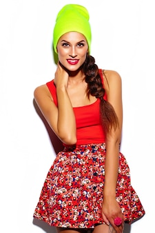 Glamour stylish beautiful  young woman model with red lips  in summer bright colorful  hipster cloth in yellow beanie