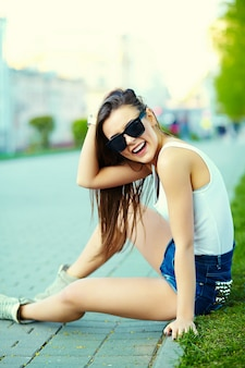 Glamour stylish woman model in summer bright cloth in the street