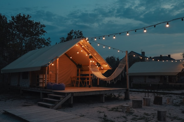 Glamping tent in the forest. luxury tent sea view. nature green tourism