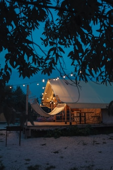 Glamping tent in the forest. luxury tent sea view. nature green tourism.