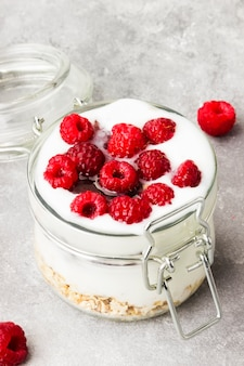 Glanola in glass jar with raspberry and mint