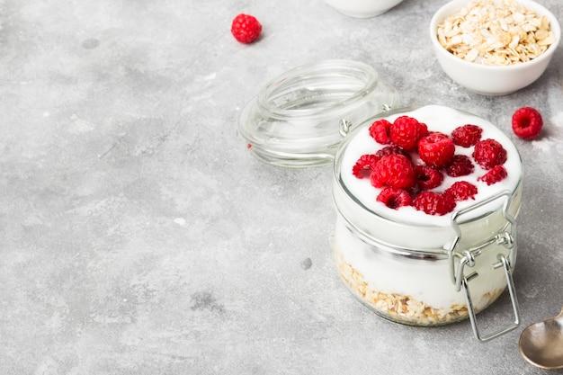 Glanola in glass jar with raspberry