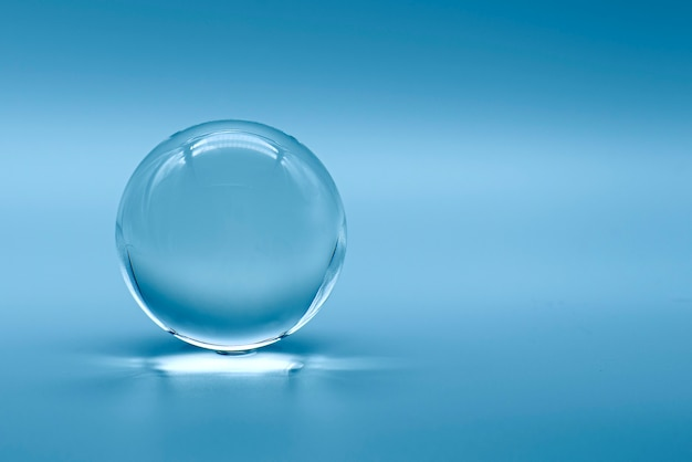 Glass ball on blue background